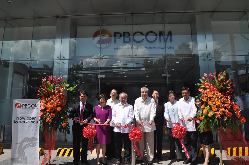 The ribbon cutting ceremony during the PBCOM J.P. Rizal - Makati Branch inauguration was led by (from left): J.P. Rizal - Makati Branch Manager Ariel Santos; President & CEO Patricia May T. Siy; Branch Banking Group Head Victor Lim; Special Guest Philip Chung; Director Roberto Lorayes; Branch Banking Luzon Group Head James Go; Executive Director Carmen Huang; Director Henry Uy; and South Metro Region Head Nida Capistrano.